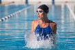 professional swimmer, water splashing, goggles and swimming cap