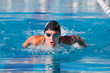 Butterfly swimmer in cap and glasses in the pool - 73919516
