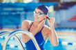Portrait of a young woman in goggles and swimming cap - 73919557
