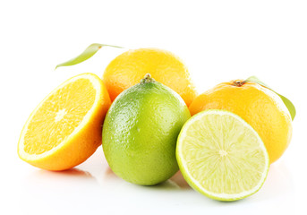 Fresh juicy limes and oranges isolated on white