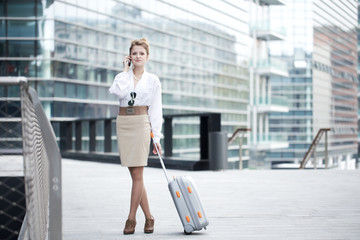businesswoman walking and talking to mobile