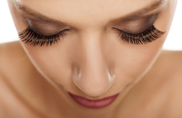close up of eyes with long artificial eyelashes