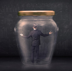 Business man closed into a glass jar concept