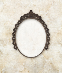 old oval picture frame metal worked on marble background