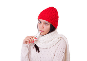 Young ill unhappy woman holding thermometer in her mouth