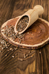 Flax seeds in wooden scoop