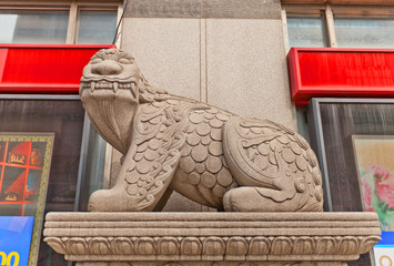 Statue of lion-like creature Haechi on the street of Seoul