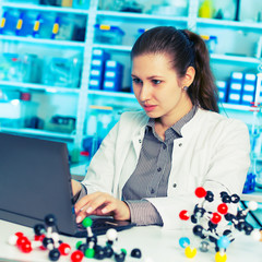 young woman scientist working at th