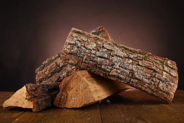 Heap of firewood on floor on dark background