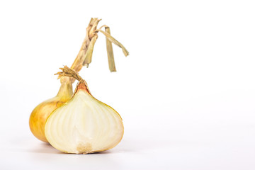 Half and whole onions, isolated on white background
