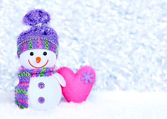 New Year 2015, Snowman with pink handmade heart on snow