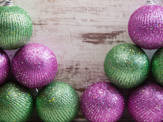 christmas balls in a stack over wooden background