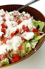 Green salad with red vegetables and yogurt