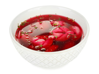Traditional polish clear red borscht with dumplings isolated