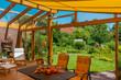 Leinwanddruck Bild - Sommerliche Terrasse und Garten