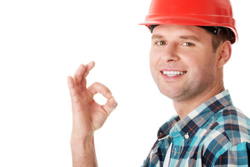 Confident engineer showing OK sign