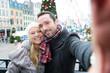 Obrazy na płótnie, fototapety, zdjęcia, fotoobrazy drukowane : Young couple on holidays taking selfie