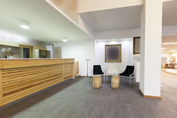 Spacious hotel lobby with reception desk