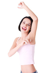 Young happy woman shaving armpit