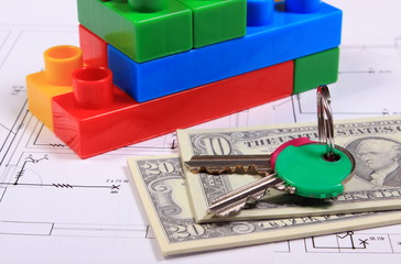 Banknotes, keys and building blocks on drawing of house