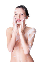 Portrait of young sexy woman with soap foam