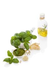 Basil pesto with ingredietns.