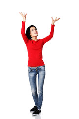 Full length woman holding a copyspace up high