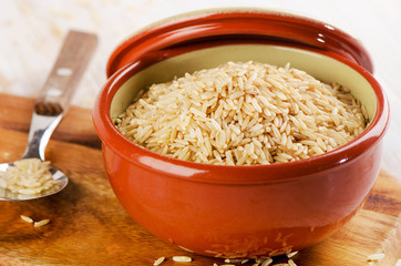 natural brown rice in a   bowl .
