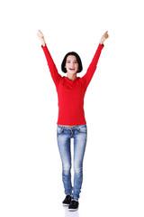 Full length woman in a winner gesture