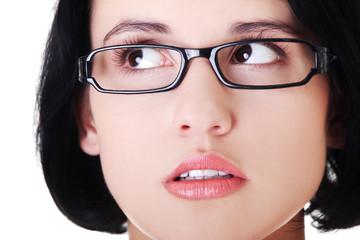 Portrait of a woman in eyewear looking up