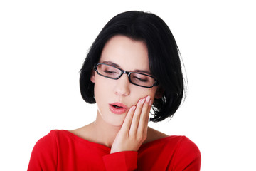 Young woman suffering from toothache