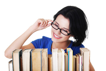Happy woman searching for an interesting book