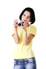 Young student woman with a photo camera