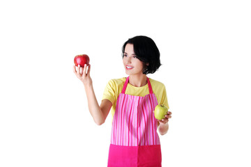 Woman in kitchen apron holding apples