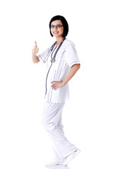Full length female doctor gesturing thumbs up