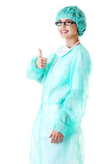 Female doctor gesturing thumbs up