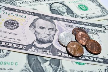 Dollar bills with coins