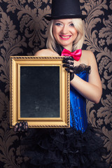 beautiful cabaret woman posing with golden frame against retro w
