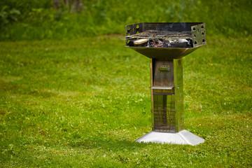 grill on grass lane