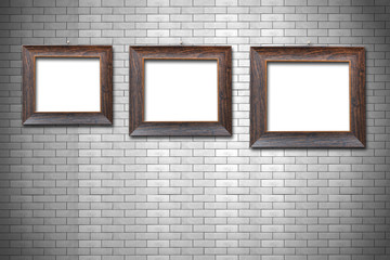 Wooden frame on brick wall background
