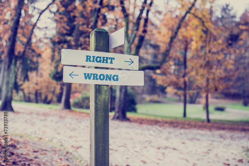Poster Opposite directions towards right and wrong