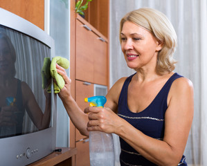 woman  cleaning TV with cleanser