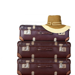 Old suitcase with women's hat