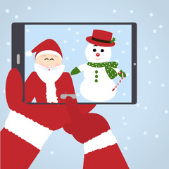 Santa Claus selfie with snowman