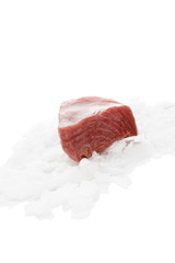 Fresh tuna steak on ice isolated on white.