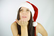 Woman santa blowing from hand