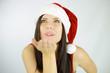 Woman santa blowing from hand