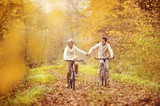 Active seniors riding bike - 73938367