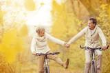 Active seniors riding bike - 73938388