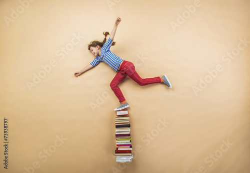 Girl with books - 73938797